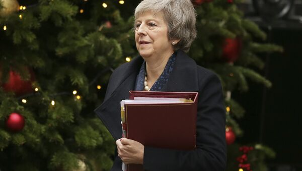 Britain's Prime Minister Theresa May leaves 10 Downing Street to attend the weekly Prime Ministers' Questions session, at parliament in London, Wednesday, Dec. 12, 2018. May has confirmed there will be a vote of confidence in her leadership of the Conservative Party, in Parliament Wednesday evening, with the result expected to be announced soon after. - Sputnik International