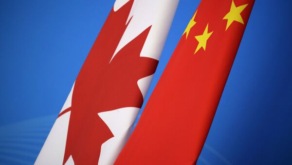 Flags of Canada and China are placed for the first China-Canada economic and financial strategy dialogue in Beijing, China, Monday, Nov. 12, 2018 - Sputnik International
