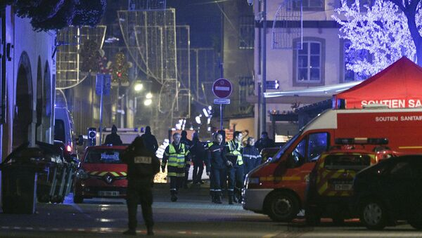Policemen and emergency medical response vehicules are seen in the rue des Grandes Arcades in Strasbourg, eastern France, after a shooting breakout, on December 11, 2018. - Sputnik International