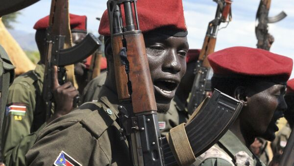 In this photo taken Thursday, April 14, 2016, government soldiers follow orders to raise their guns during a military parade in Juba, South Sudan - Sputnik International