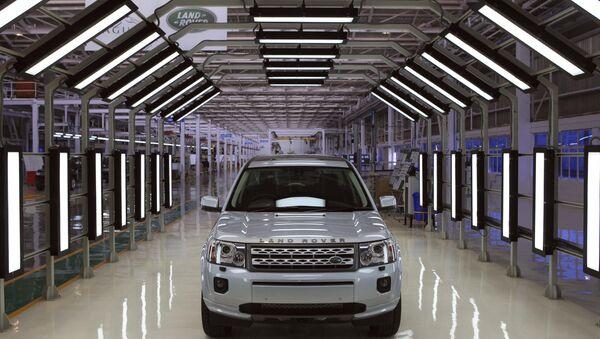 A Jaguar Land Rover car sits at an assembly plant in Pune, India - Sputnik International