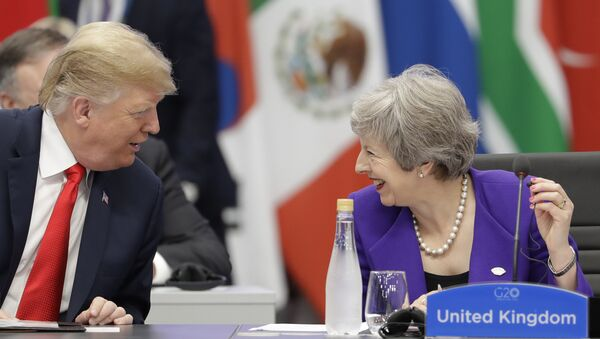 Britain's Prime Minister Theresa May, right, speaks with President Donald Trump during the G20 summit in Buenos Aires, Argentina, Friday, Nov. 30, 2018 - Sputnik International