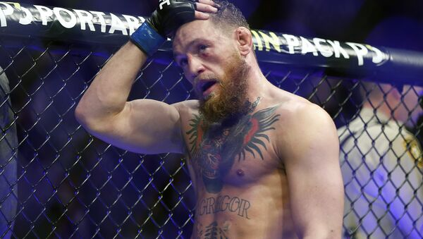 Conor McGregor reacts after losing to Khabib Nurmagomedov in a lightweight title mixed martial arts bout at UFC 229 in Las Vegas, Saturday, Oct. 6, 2018 - Sputnik International