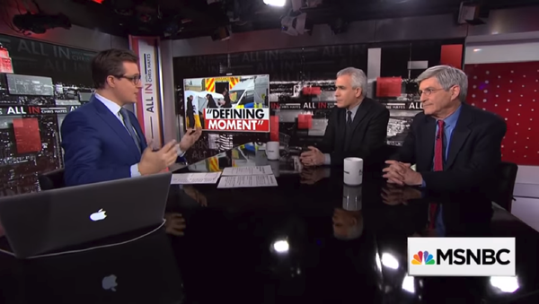 Journalist Michael Isikoff and co-author of his book on Russiagate, David Corn, talk to MSNBC's Chris Hayes about the relationship between US President Donald Trump and Russian President Vladimir Putin. - Sputnik International