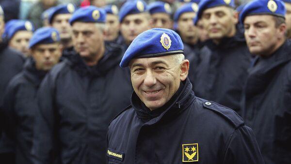 In this photo taken Oct. 24, 2003, former Police Gen. Goran Radosavljevic Guri stands in front of Serbia's elite police troops during a protest in downtown Belgrade, Serbia. - Sputnik International