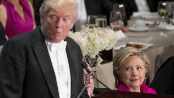 Republican presidential candidate Donald Trump, left, accompanied by Democratic presidential candidate Hillary Clinton, right, speaks at the 71st annual Alfred E. Smith Memorial Foundation Dinner, a charity gala organized by the Archdiocese of New York, Thursday, Oct. 20, 2016, at the Waldorf Astoria hotel in New York - Sputnik International