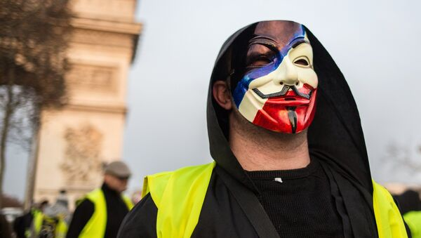 A protester takes part in a demonstration of the yellow vests movement in Paris, France. - Sputnik International