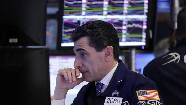 In this Dec. 6, 2018, specialist Peter Mazza works at his post on the floor of the New York Stock Exchange. - Sputnik International