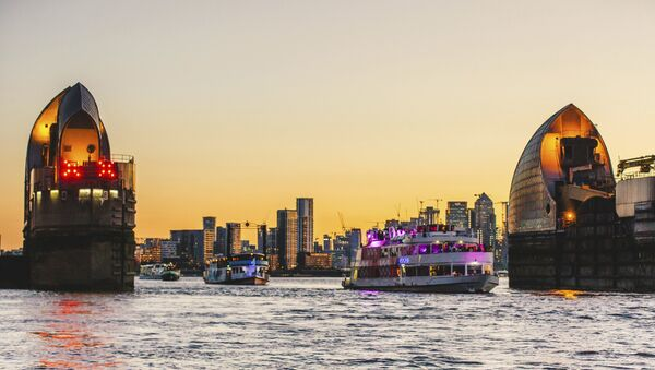 The boats travel through the Thames Barrier at sunset as the river plays host to an epic voyage through British music culture at Red Bull Music Odyssey in London, England - Sputnik International