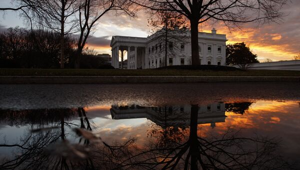 The sun rises behind the White House in Washington, Saturday, Dec. 22, 2018. Hundreds of thousands of federal workers faced a partial government shutdown early Saturday after Democrats refused to meet President Donald Trump's demands for $5 billion to start erecting a border wall with Mexico - Sputnik International