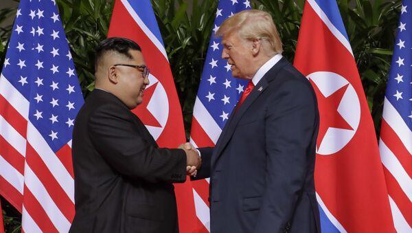 U.S. President Donald Trump shakes hands with North Korea leader Kim Jong Un at the Capella resort on Sentosa Island Tuesday, June 12, 2018 in Singapore. - Sputnik International