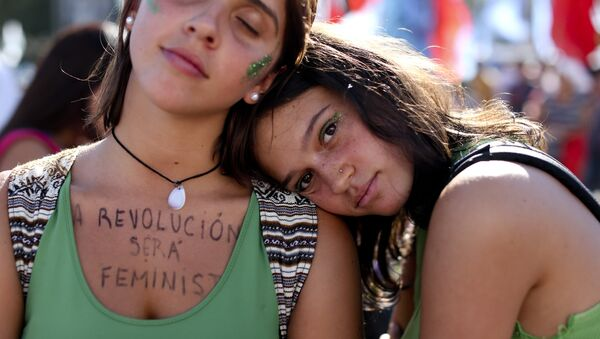 A woman wears a message on her chest that reads in Spanish: The revolution is feminist during a demonstration celebrating International Women's Day, in Buenos Aires, Argentina, Thursday, March 8, 2018 - Sputnik International
