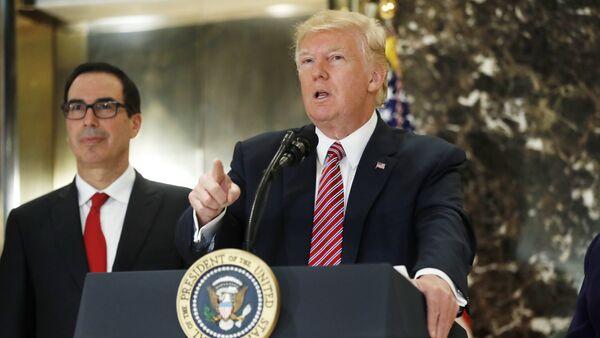 President Donald Trump, accompanied by Treasury Secretary Steven Mnuchin, speaks to the media in the lobby of Trump Tower in New York, Tuesday, Aug. 15, 2017 - Sputnik International