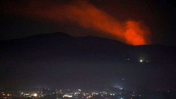 Smoke rises past a mountain as seen from Damascus countryside, Syria December 25, 2018 - Sputnik International