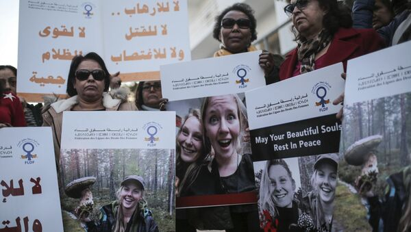 Moroccan women carry photos of 28-year-old Norwegian Maren Ueland and 24-year-old Danish Louisa Vesterager Jespersen, during a candlelight vigil outside the Danish embassy in Rabat for the two Scandinavian university students who were killed in a terrorist attack in a remote area of the Atlas Mountains, Morocco, Saturday, Dec. 22, 2018 - Sputnik International