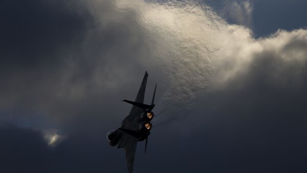 Israeli Air Force F-15 plane performs during a graduation ceremony for new pilots in the Hatzerim air force base near the city of Beersheba, Israel, Thursday, Dec. 29, 2016 - Sputnik International