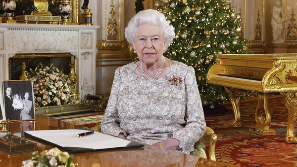 In this photo released on Monday, Dec. 24, 2018, Queen Elizabeth II poses after she recorded her annual Christmas Day message, in the White Drawing Room of Buckingham Palace in central London - Sputnik International