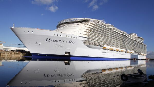 In this Feb. 18, 2016 file photo, the Harmony of the Seas docks at the STX Shipyard in Saint-Nazaire, western France. Tens of thousands of French well-wishers waved revoir to the largest cruise ship in the world as it set sail on its maiden voyage to the U.K. after 32 months in a French shipyard. - Sputnik International