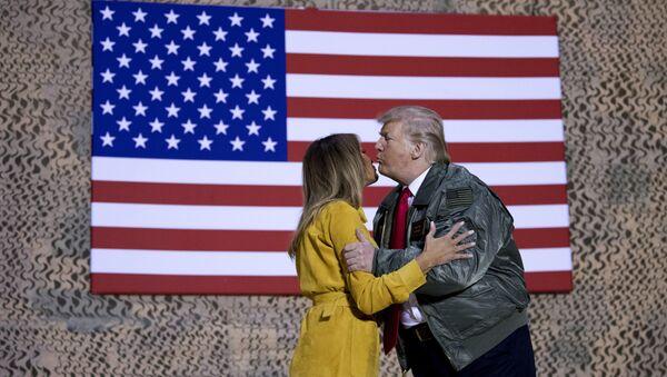 President Donald Trump kisses first lady Melania Trump during a hanger rally at Al Asad Air Base, Iraq, Wednesday, Dec. 26, 2018 - Sputnik International