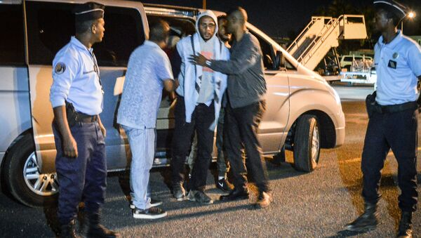 French national Peter Cherif (C) alleged associate of the Kouachi brothers, perpetrators of 2015 Charlie Hebdo attack, steps out a car as he is extradited to France at Djibouti International Airport in Djibouti on December 22, 2018 - Sputnik International