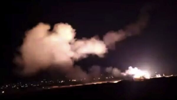 This frame grab from a video provided by the Syrian official news agency SANA shows missiles flying into the sky near Damascus, Syria, Tuesday, Dec. 25, 2018 - Sputnik International
