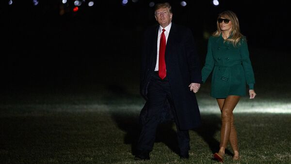 President Donald Trump and first lady Melania Trump arrive on the South Lawn of the White House after making a surprise visit to troops in Iraq, Thursday, Dec. 27, 2018, in Washington - Sputnik International