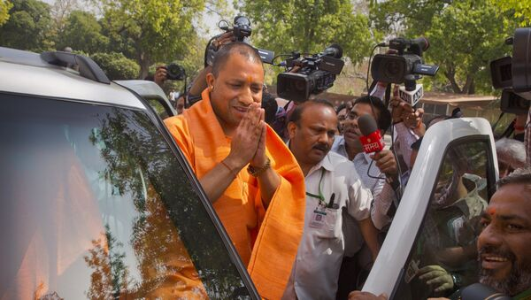 The new Chief Minister of the northern Indian state of Uttar Pradesh Yogi Adityanath greets media as he arrives at the Parliament in New Delhi, India, Tuesday, March 21, 2017 - Sputnik International