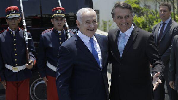 Israeli Prime Minister Benjamin Netanyahu, left center, is received by Brazil's President-elect Jair Bolsonaro at the military base Fort Copacabana, in Rio de Janeiro, Brazil, Friday, Dec. 28, 2018. - Sputnik International