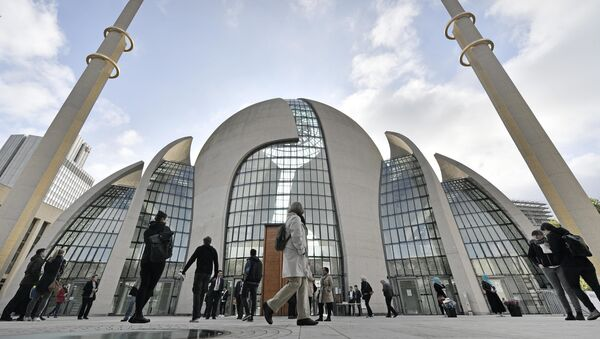 FILE - In this Oct. 3, 2017 file photo people stand outside the new central DITIB mosque on the Day of Open Mosques in Cologne. The controversial new mosque by the organization of Turkish-Islamic Union for Religious Affairs is the largest mosque in Germany - Sputnik International