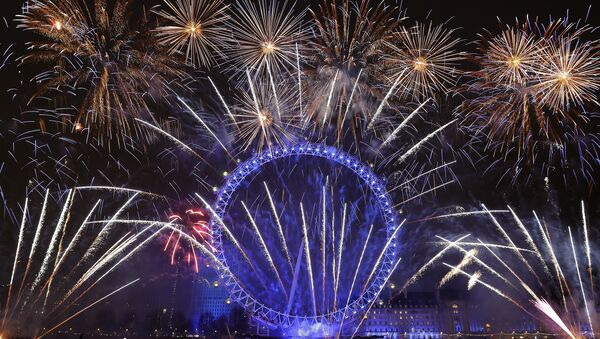 Fireworks explode over the London Eye during the New Year's eve celebrations after midnight in London, Tuesday, Jan. 1, 2019 - Sputnik International