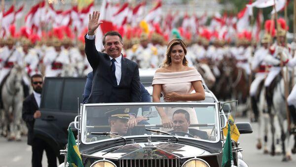 Brazil's new President Jair Bolsonaro waves as he drives past before his swear-in ceremony - Sputnik International