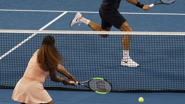 Roger Federer of Switzerland returns the ball to Serena Williams of the United states during their mixed doubles match at the Hopman Cup in Perth, Australia, Tuesday, 1, Jan. 2019 - Sputnik International