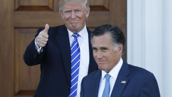 In this Nov. 19, 2016, file photo, shows President-elect Donald Trump giving the thumbs-up as Mitt Romney leaves Trump National Golf Club Bedminster in Bedminster, N.J. - Sputnik International