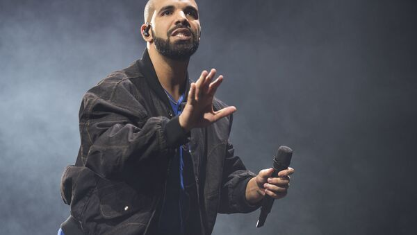 In this Oct. 8, 2016 file photo, Drake performs onstage in Toronto. Drake along with Rihanna and Kanye West scored eight Grammy nominations each, announced Tuesday, Dec. 6. - Sputnik International