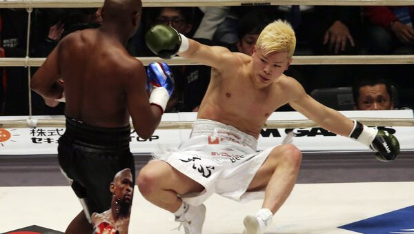 Japanese kickboxer Tenshin Nasukawa lies on the mat after being knocked out by Floyd Mayweather Jr. during first round of their three-round exhibition match on New Year's Eve, at Saitama Super Arena in Saitama, north of Tokyo, Monday, Dec. 31, 2018. - Sputnik International