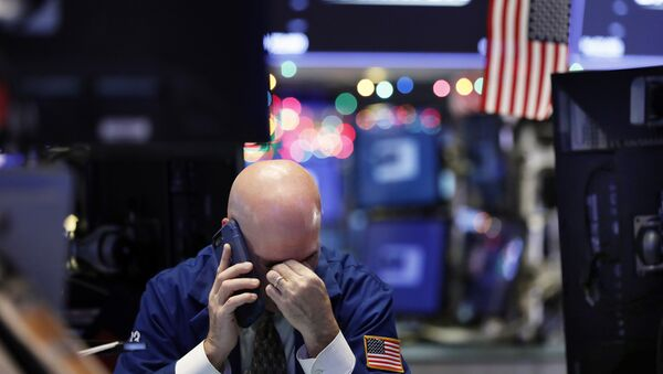 A trader talks on his phone on the floor of the New York Stock Exchange - Sputnik International