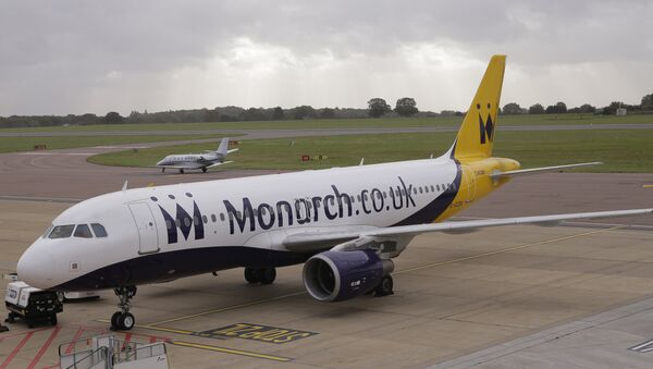 A Monarch Airlines plane, on the tarmac at Luton Airport in Luton, England - Sputnik International