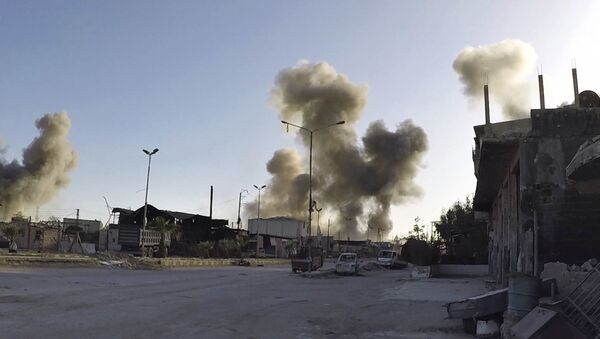 This photo released by the Syrian Civil Defense White Helmets - Sputnik International