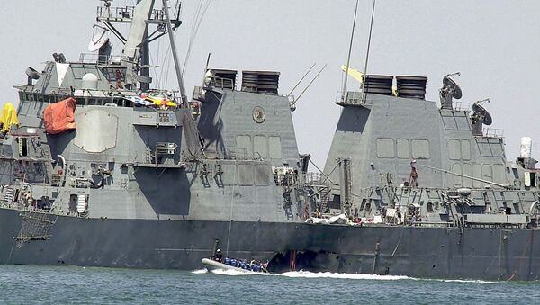 In Sunday, Oct. 15, 2000 file photo, experts in a speed boat examine the damaged hull of the USS Cole at the Yemeni port of Aden after a powerful explosion ripped a hole in the U.S Navy destroyer in the Yemeni port, killing 17 sailors and injuring some 30 others. A federal appeals court on Thursday, June 20, 2013 reinstated a lawsuit by the families of 17 sailors killed in the 2000 bombing of the USS Cole. A three-judge panel of the 4th U.S. Circuit Court of Appeals on Thursday reversed a lower court's dismissal of the lawsuit against Sudan. - Sputnik International