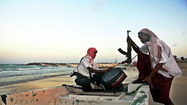 Somali pirates carrying out preparations to a skiff in Hobyo, northeastern Somalia. File photo - Sputnik International