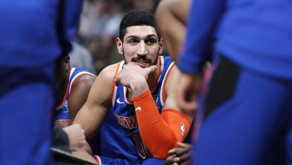 New York Knicks center Enes Kanter jokes with teammates during a timeout the first half of the team's NBA basketball game against the Denver Nuggets on Tuesday, Jan. 1, 2019 - Sputnik International