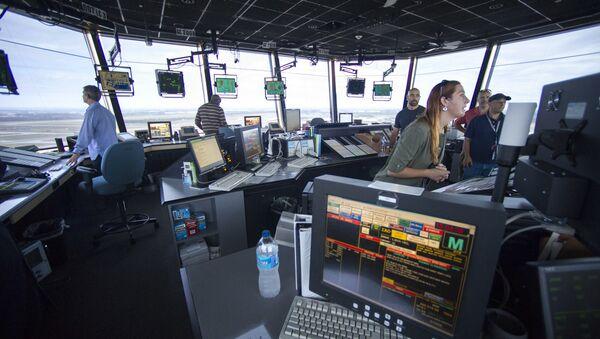 FAA Air Traffic Controllers work in the Dulles International Airport Air Traffic Control Tower in Sterling, Va - Sputnik International