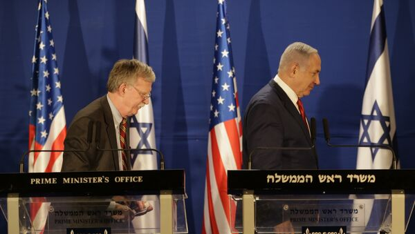Israeli Prime Minister Benjamin Netanyahu, right, and US National Security Advisor John Bolton, leave the stage after their statement to the media follow their meeting, in Jerusalem, Sunday, Jan. 6, 2019. - Sputnik International