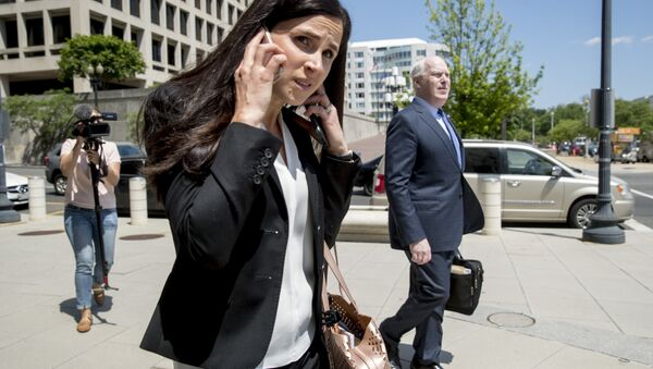 Attorneys Eric Dubelier, right, and Katherine Seikaly, left, representing Concord Management and Consulting LLC, walk out of federal court in Washington, Wednesday, May 9, 2018. - Sputnik International