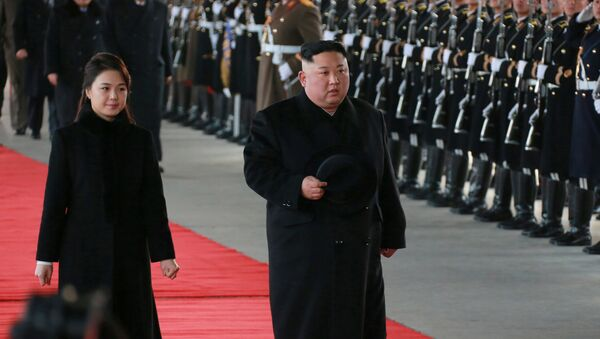 North Korean leader Kim Jong Un and wife Ri Sol Ju inspect an honour guard before leaving Pyongyang for a visit to China, this January 7, 2019 photo released by North Korea's Korean Central News Agency (KCNA) in Pyongyang January 8, 2019. - Sputnik International