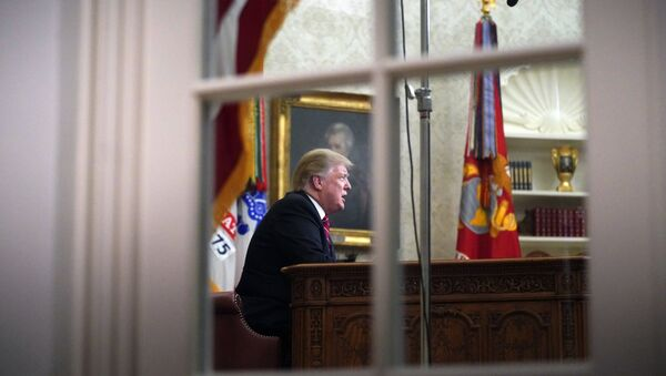 As seen from a window outside the Oval Office, President Donald Trump gives a prime-time address about border security Tuesday, Jan. 8, 2018, at the White House in Washington - Sputnik International