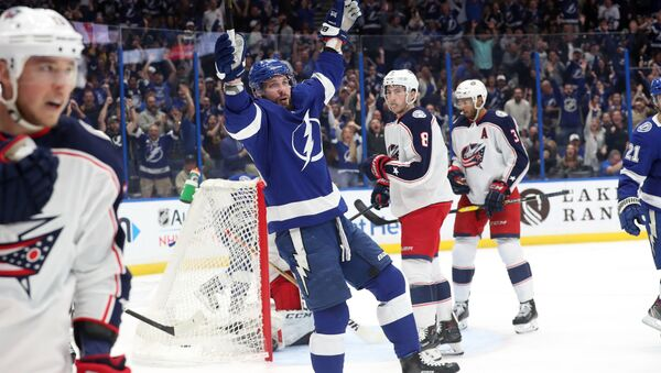 Jan 8, 2019; Tampa, FL, USA; Tampa Bay Lightning right wing Nikita Kucherov (86) celebrates after assisting on a goal by center Brayden Point (not pictured) against the Columbus Blue Jackets during the first period at Amalie Arena - Sputnik International