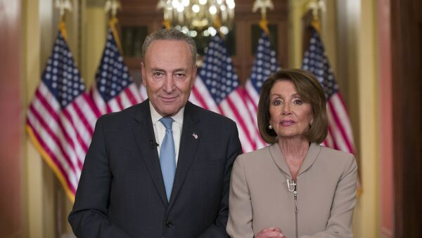 Senate Minority Leader Chuck Schumer of N.Y., and House Speaker Nancy Pelosi of Calif., pose for photographers after speaking on Capitol Hill in response President Donald Trump's address, Tuesday, Jan. 8, 2019, in Washington - Sputnik International