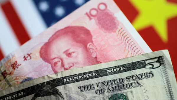 US Dollar and China Yuan notes are seen in this picture illustration June 2, 2017 - Sputnik International