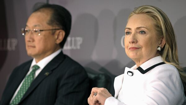 (File photo) World Bank President Jim Yong Kim, left, and Secretary of State Hillary Rodham Clinton wait to address the Gallup Evidence and Impact: Closing the Gender Data Gap conference in Washington, Thursday, July 19, 2012 - Sputnik International